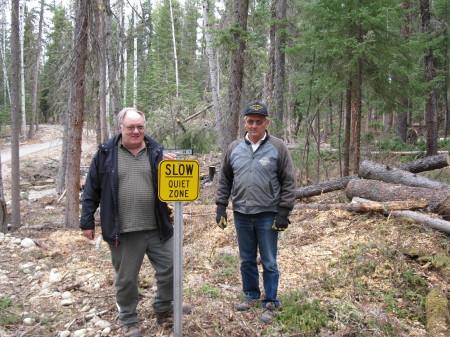 Alex and Don, installing signs in the park, Leroy taking picture