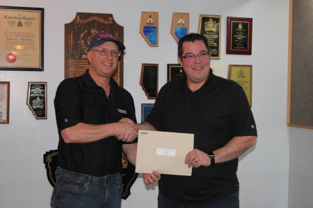 Feb 2017, Pembina, Trevor Shand presented a donation to Aaron Munro, President